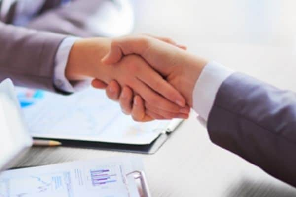 SMC Global Securities Limited partners Dhanlaxmi Bank